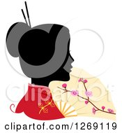 Clipart Of A Silhouetted Black Chinese Womans Face With A Colored Kimono And Fan Royalty Free Vector Illustration by BNP Design Studio