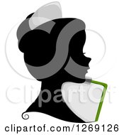 Clipart Of A Silhouetted Black Nurse Womans Face With A Colored Chart Clipboard Royalty Free Vector Illustration by BNP Design Studio