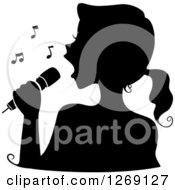 Clipart Of A Silhouetted Black Singing Womans Face With A Microphone And Music Notes Royalty Free Vector Illustration by BNP Design Studio
