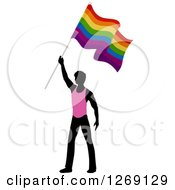 Clipart Of A Black Silhouetted Man In A Pink Shirt Holding Up A Rainbow Gay Pride Flag Royalty Free Vector Illustration