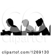 Clipart Of Gray And Black Silhouetted Students Taking An Exam Royalty Free Vector Illustration