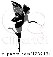 Clipart Of A Silhouetted Black And White Flying Fairy Using A Magic Wand With Pink Waves Royalty Free Vector Illustration