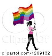 Clipart Of A Silhouetted Black Woman Wearing A Pink Shirt And Walking With A Gay Pride Flag Royalty Free Vector Illustration