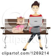 Brunette Caucasian Woman Using A Laptop And Sitting On A Park Bench With Her Dog