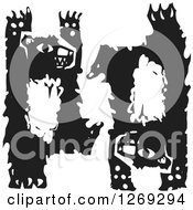 Clipart Of Black And White Woodcut Bears Standing And Doing A Handstand Royalty Free Vector Illustration