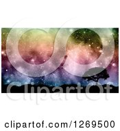 Clipart Of A 3d Silhouetted Tree And Hills Against A Colorful Nebula Starry Sky Royalty Free Illustration by KJ Pargeter
