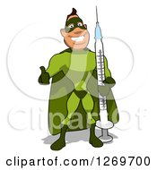 Clipart Of A Cartoon Green White Male Super Hero Holding A Thumb Up And Standing With A Giant Vaccine Syringe Royalty Free Illustration