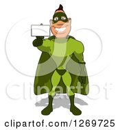 Clipart Of A Cartoon Green White Male Super Hero Holding Out A Business Card Royalty Free Illustration