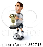 Clipart Of A 3d White German Soccer Player Facing Left Holding A Trophy And Standing Over A Ball Royalty Free Illustration