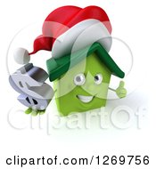 Clipart Of A 3d Happy Green Christmas House Character Giving A Thumb Up And Holding A Dollar Sign Royalty Free Illustration by Julos