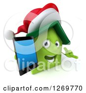 Clipart Of A 3d Happy Green Christmas House Character Holding Up A Smart Phone And Gesturing To Call Royalty Free Illustration