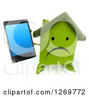 3d Unhappy Green House Character Holding Up A Smart Phone
