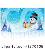 Clipart Of A Snowman Holding A Gift On A Snowy Winter Hill Royalty Free Vector Illustration