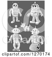 Clipart Of Grayscale Robots And Dogs Over Gray Royalty Free Vector Illustration by visekart