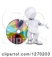 Clipart Of A 3d White Man Presenting And Standing With A Giant CD DVD Or Blu Ray Disk Royalty Free Illustration