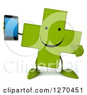Clipart Of A 3d Happy Green Pharmaceutical Cross Character Holding And Pointing To A Smart Phone Royalty Free Illustration