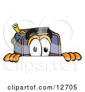 Clipart Picture Of A Suitcase Cartoon Character Peeking Over A Surface