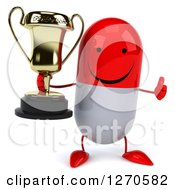Clipart Of A 3d Happy Red And White Pill Character Holding A Trophy And Thumb Up Royalty Free Illustration