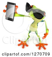Clipart Of A 3d Argie Frog Wearing Sunglasses Facing Left And Holding Up A Smart Phone Royalty Free Illustration