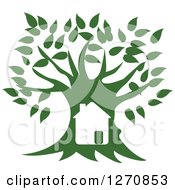 Clipart Of A House In A Large Green Tree Royalty Free Vector Illustration by Eugene #COLLC1270853-0054