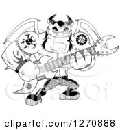 Clipart Of A Black And White Heavy Metal Devil Playing An Electric Guitar Royalty Free Vector Illustration