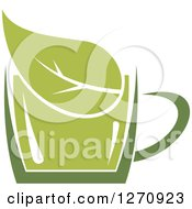 Clipart Of A Two Toned Steamy Hot Green Tea Cup And A Leaf Royalty Free Vector Illustration
