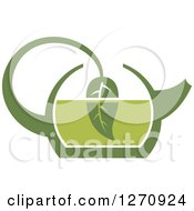 Clipart Of A Two Toned Steamy Green Tea Kettle And A Leaf Royalty Free Vector Illustration
