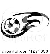 Clipart Of A Black And White Soccer Ball And Flames Royalty Free Vector Illustration