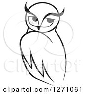 Clipart Of A Black And White Owl With Long Brows Royalty Free Vector Illustration