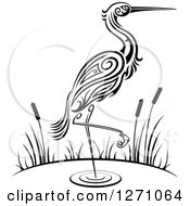 Clipart Of A Black And White Wading Tribal Crane With Cattails Royalty Free Vector Illustration