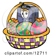 Clipart Picture Of A Suitcase Cartoon Character In An Easter Basket Full Of Decorated Easter Eggs
