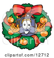Clipart Picture Of A Suitcase Cartoon Character In The Center Of A Christmas Wreath