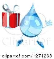 Clipart Of A 3d Water Drop Character Jumping And Holding A Gift Royalty Free Illustration