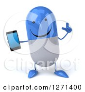 Clipart Of A 3d Happy Blue And White Pill Character Holding Up A Finger And A Smart Phone Royalty Free Illustration