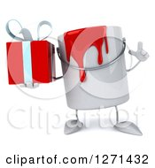3d Can Of Red Paint Character Holding Up A Finger And A Gift