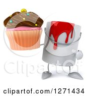 Clipart Of A 3d Can Of Red Paint Character Holding And Pointing To A Chocolate Frosted Cupcake Royalty Free Illustration