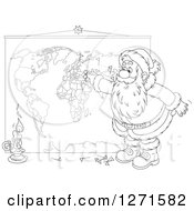 Clipart Of A Black And White Christmas Santa Inserting Pins Into A World Map Royalty Free Vector Illustration