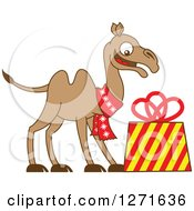 Clipart Of A Christmas Camel Wearing A Scarf And Smiling Down At A Gift Royalty Free Vector Illustration