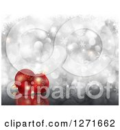 Clipart Of A Christmas Background Of 3d Red Baubles Over Silver Bokeh And Snowflakes Royalty Free Illustration