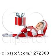 3d Young White Male Super Hero Santa Resting And Holding A Christmas Gift 2