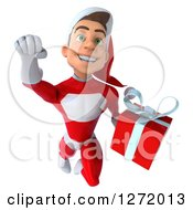 3d Young White Male Super Hero Santa Flying Forward And Holding A Christmas Gift