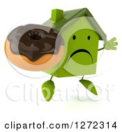 Clipart Of A 3d Unhappy Green House Character Facing Slightly Right Jumping And Holding A Chocolate Frosted Donut Royalty Free Illustration