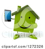Clipart Of A 3d Happy Green House Character Holding And Pointing To A Smart Phone Royalty Free Illustration