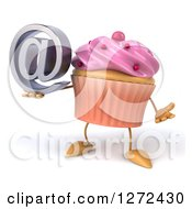Clipart Of A  3d Pink Frosted Cupcake Character Shrugging And Holding An Email Arobase Symbol Royalty Free Illustration