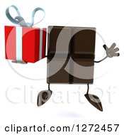 Clipart Of A 3d Chocolate Candy Bar Character Jumping And Holding A Gift Royalty Free Illustration