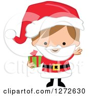 Clipart Of A Caucasian Christmas Boy Wearing A Santa Suit And Holding A Gift Royalty Free Vector Illustration
