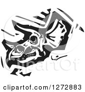 Clipart Of A Black And White Woodcut Triceratops Skull Royalty Free Vector Illustration by xunantunich