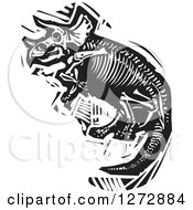 Clipart Of A Black And White Woodcut Triceratops Skeleton Royalty Free Vector Illustration
