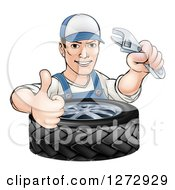 Clipart Of A Cartoon Brunette White Mechanic Man Holding An Adjustable Wrench And Thumb Up Over A Tire Royalty Free Vector Illustration