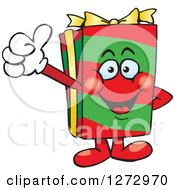 Clipart Of A Happy Christmas Gift Character Giving A Thumb Up Royalty Free Vector Illustration